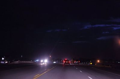 picture of cars driving at night