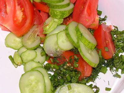 picture of cucumbers, tomatoes, and onions