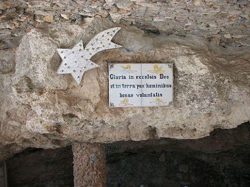 sign over grotto in Shepherd's Field, near Bethlehem, reading Gloria in excelsis Deo et in terra pax hominibus bonae voluntatis