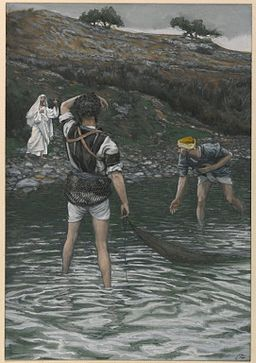 A white-robed figure on the shore and two fishermen ankle deep in water and carrying fishing nets ...