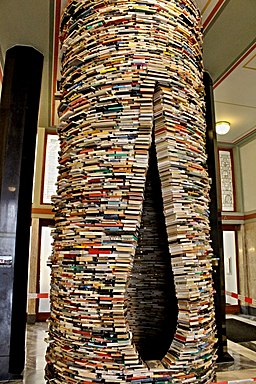 A tower of books with a almond- or vaginal-shaped opening