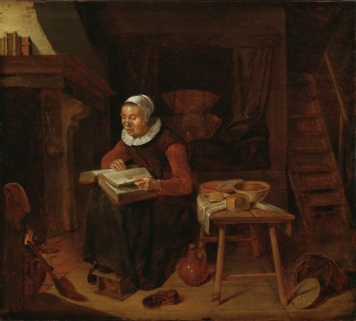 Painting of an old woman reading the Bible by a fireplace