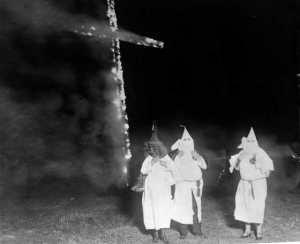 KKK members with burning cross, Denver, 1921