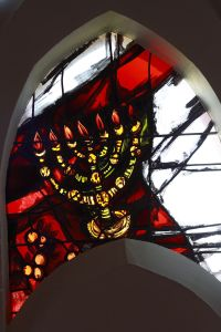 Image of a menorah in a stained glass window