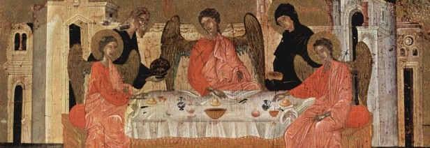 three haloed figures seated at a table being served by an elderly man and woman
