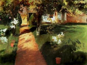 garden path leading to a house with Easter lilies