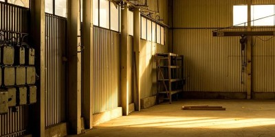 shaft of sunlight in an empty unused workshop