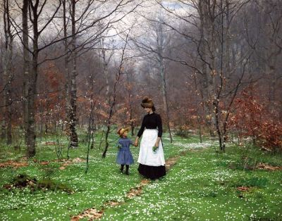 Woman and girl walking through spring woods