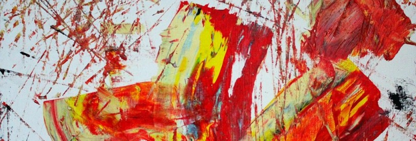 fragment of an abstract painting red yellow black white