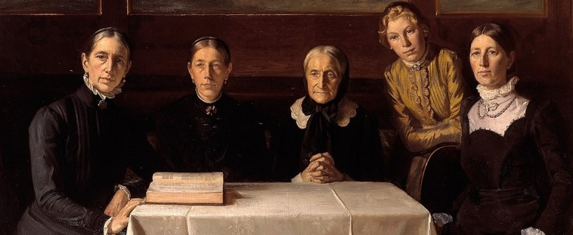 five 19th century women around a table with an open Bible