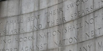"inscription ""They shall beat their swords into plowshares and their spears into pruning hooks; nation shall not lift up sword against nation, neither shall they learn war any more."" Isaiah"