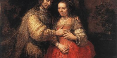 Rembrandt painting of a richly dressed century man and woman embracing