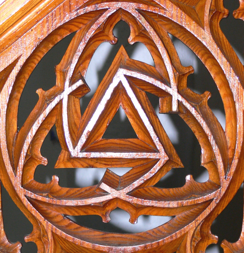 carved wood chancel symbol with triquetra and triangle