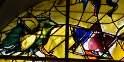 figures of bird and magen david in stained glass
