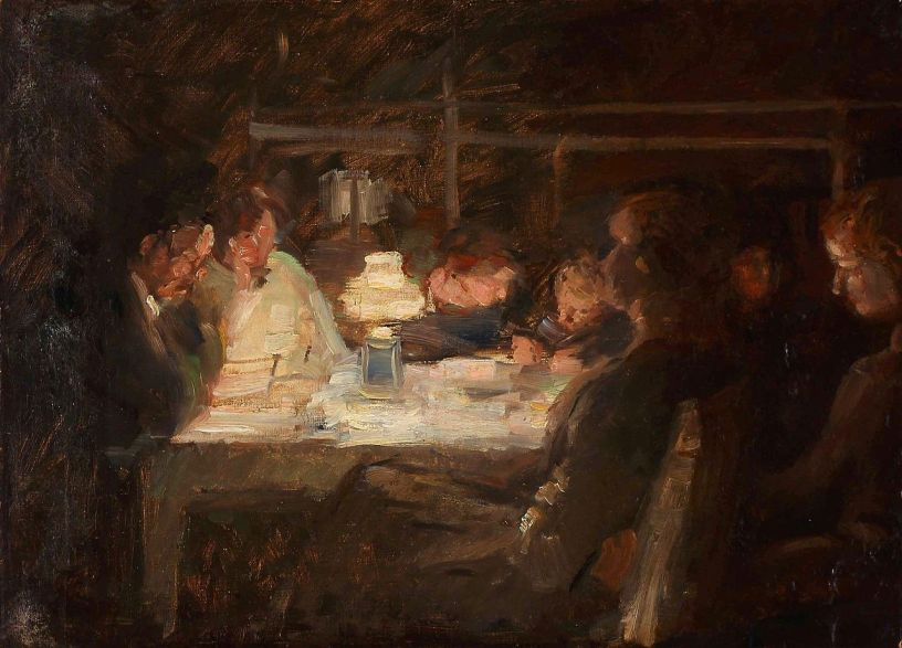family around a table at night