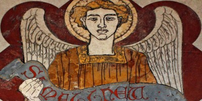 Mosaic of angel holding scroll reading St. Matthew