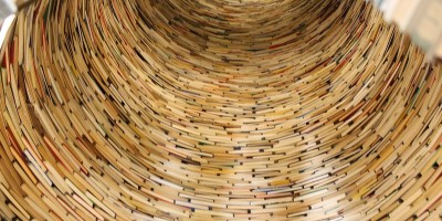 interior of large cylinder of stacked books