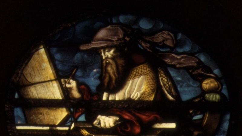 Prophet Isaiah at a writing desk